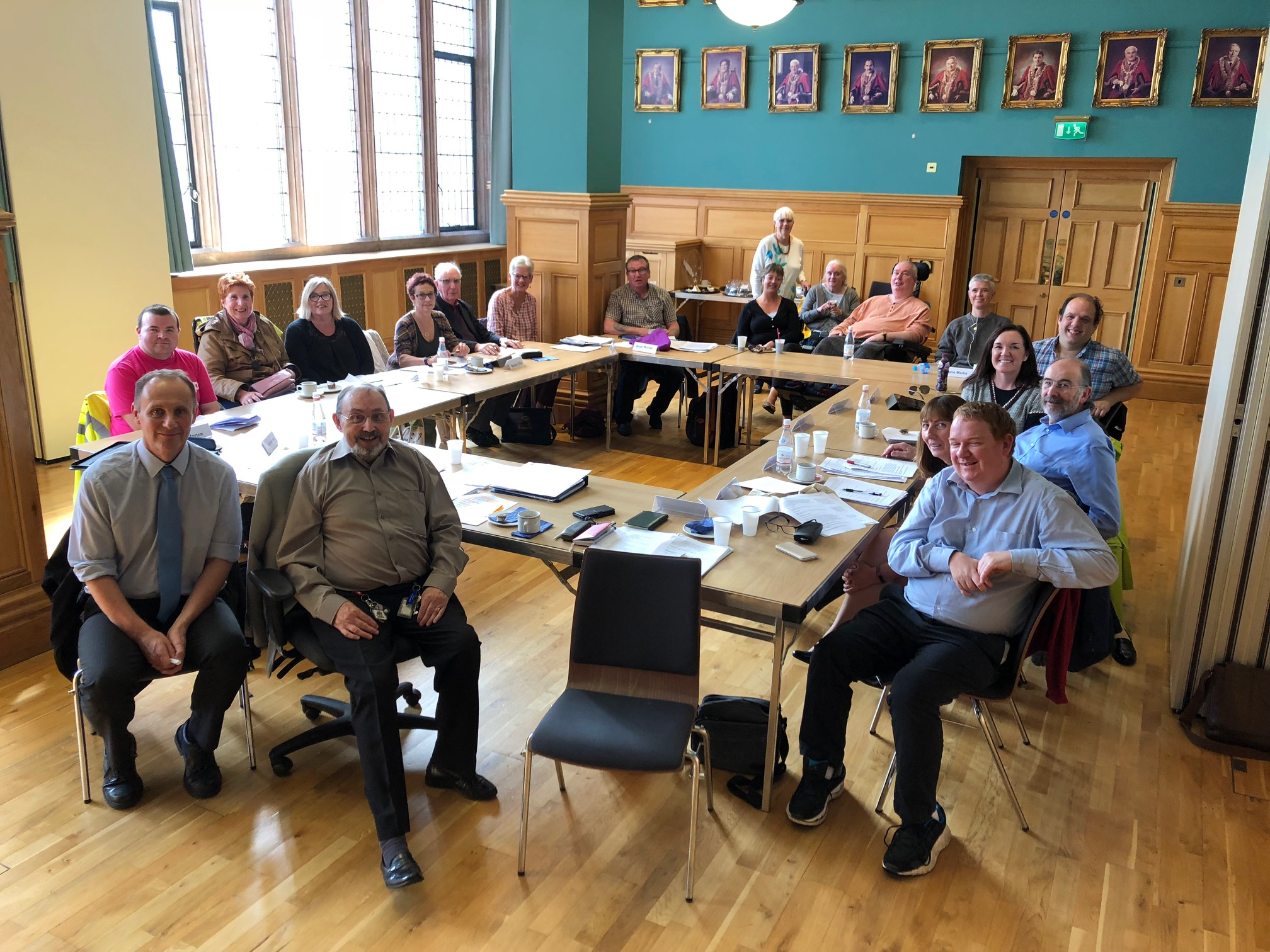 Image shows Imtac members at a meeting in Derry